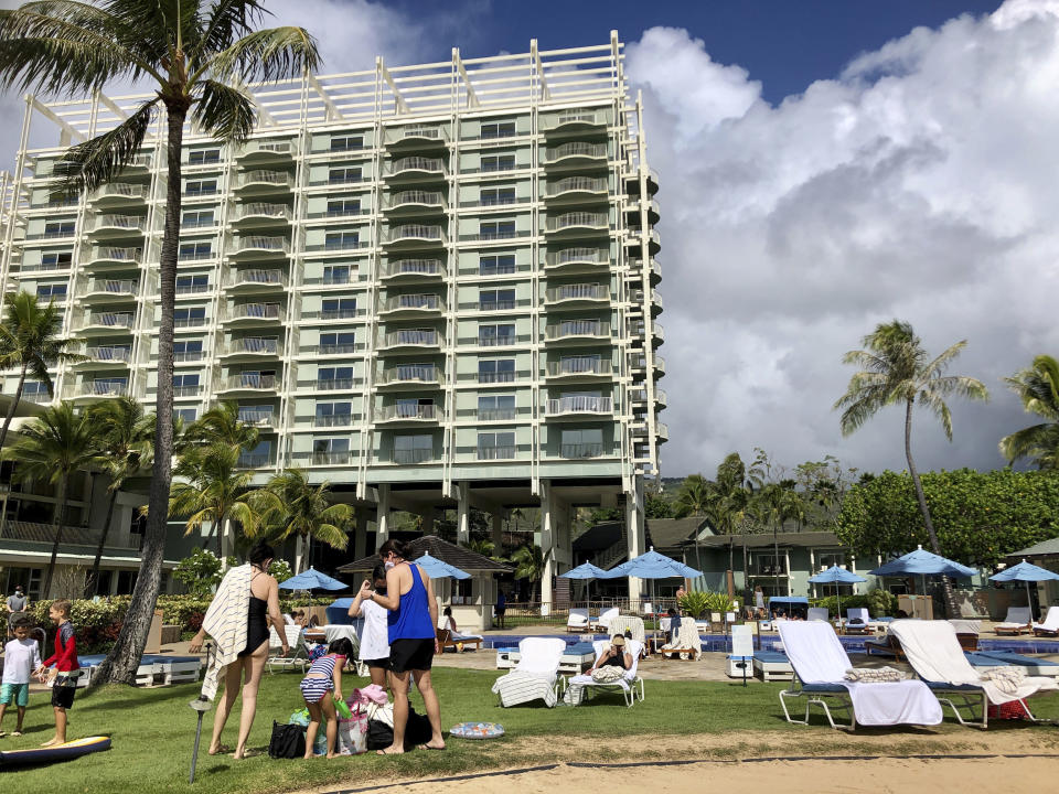 Guests are seen poolside at the Kahala Hotel & Resort in Honolulu, Sunday, Nov. 15, 2020. Some locals have mixed feelings about tourists returning during the pandemic after enjoying a Hawaii with dramatically fewer tourists since March. (AP Photo/Jennifer Sinco Kelleher)