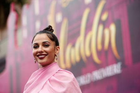 "FILE PHOTO: Cast member Naomi Scott arrives for the premiere of ""Aladdin"" at El Capitan theatre in Los Angeles, California, U.S. May 21, 2019. REUTERS/Mario Anzuoni/File Photo"