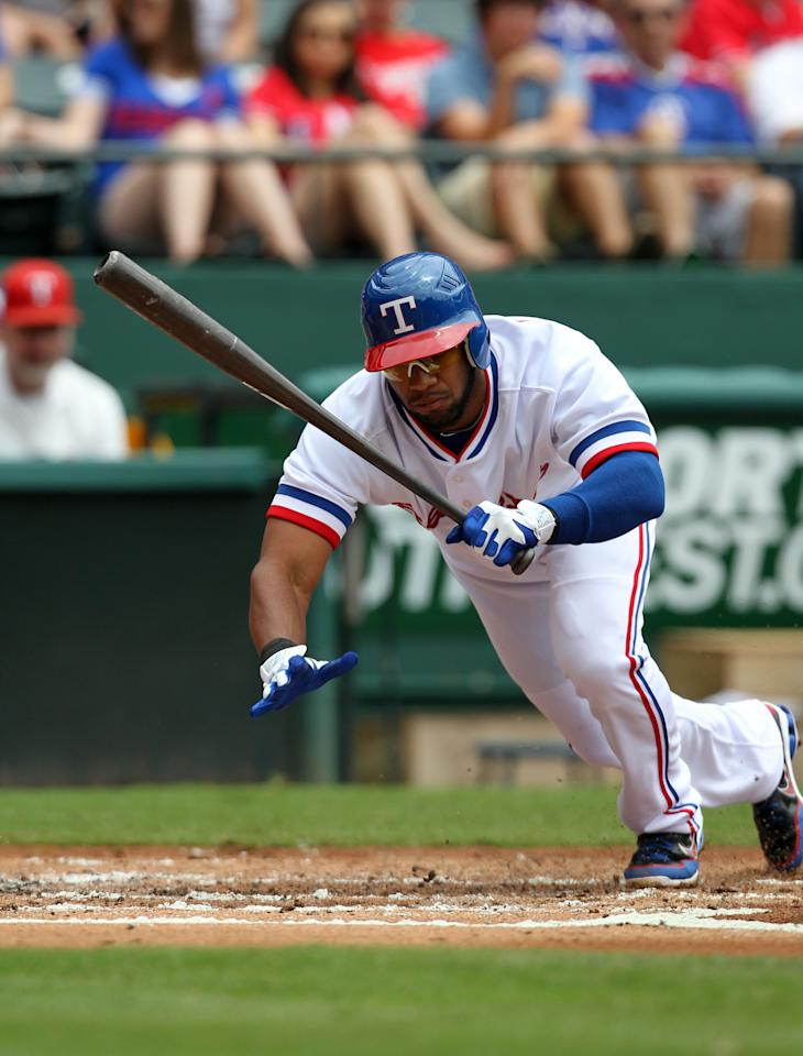 ARLINGTON, TX - MAY 12: Elvis Andrus #1 of the Texas Rangers avoids the pitch  of Los Angeles Angels of Anaheim C.J. Wilson on May 12, 2012 in Arlington, Texas. (Photo by Layne Murdoch/Getty Images)
