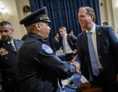 Rep. Adam Schiff, D-Calif., right, shakes hands with U.S. Capitol Police Sgt. Aquilino Gonell after a House select committee hearing on the Jan. 6 attack on Capitol Hill in Washington, Tuesday, July 27, 2021. Washington Metropolitan Police Department officer Michael Fanone is at left. (Bill O'Leary/The Washington Post via AP, Pool)