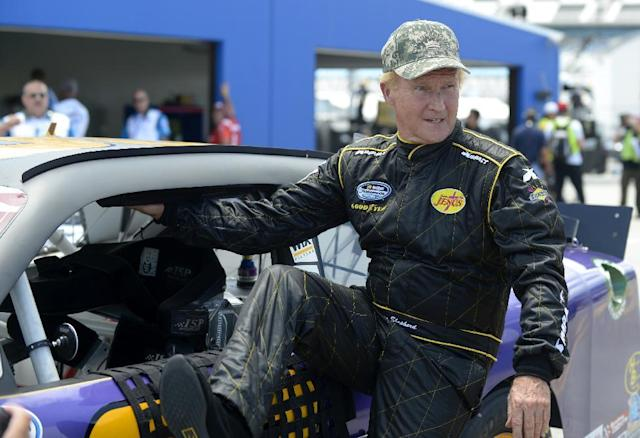 Morgan Shepherd gets out of his car after completing his laps during qualifying for the NASCAR Nationwide auto race at Daytona International Speedway in Daytona Beach, Fla., Friday, July 5, 2013.(AP Photo/Phelan M. Ebenhack)