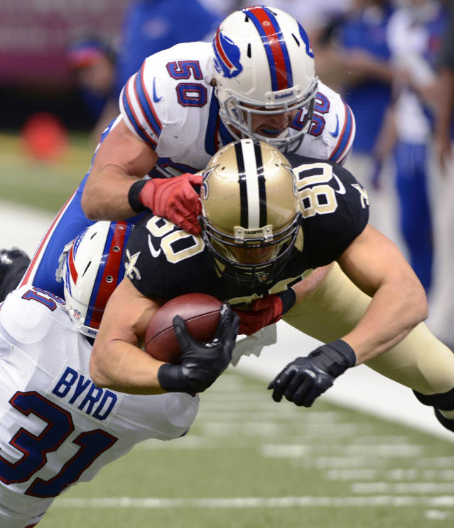 New Orleans Saints tight end Jimmy Graham (80) is tackled on a pass reception by Buffalo Bills free safety Jairus Byrd (31) and middle linebacker Kiko Alonso (50) during the first half of an NFL football game in New Orleans, Sunday, Oct. 27, 2013. (AP Photo/Bill Feig)