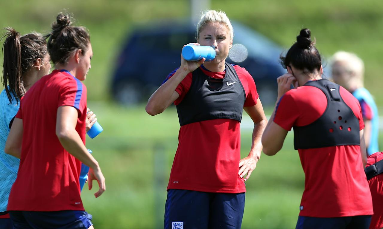 Captain Steph Houghton takes a drink during training ahead of England's game with Spain, which could determine who finishes top of Group D.