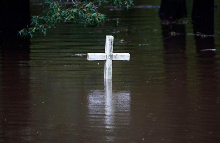 A cross is seen in flood water at a cemetery in Grifton, North Carolina.