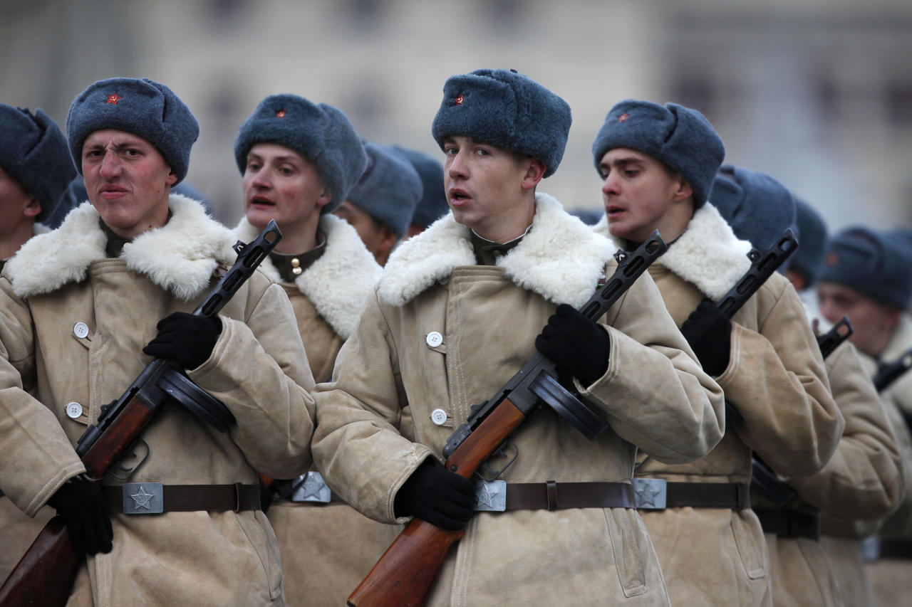 Russian soldiers dressed in Red Army World War II uniform march during a parade in Red Square in Moscow, Russia, Monday, Nov. 7, 2011.Thousands of Russian soldiers and military cadets have marched across Red Square to mark the 70th anniversary of a historic World War II parade. The show honored the participants of the Nov. 7 1941 parade who then headed directly to the front to defend Moscow from the Nazi forces. The parade Monday involved about 6,000 people, many of them dressed in World War II-era uniforms. (AP Photo/Alexander Zemlianichenko)