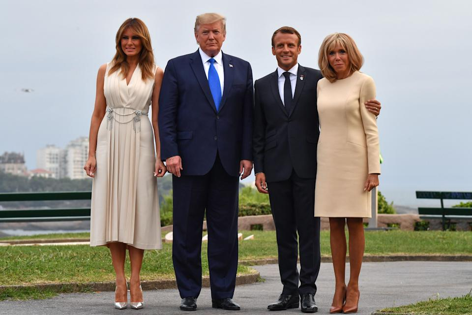 French President Emmanuel Macron and his wife, Brigitte Macron, join President Donald Trump and Melania Trump at the Biarritz lighthouse ahead of a working dinner on August 24, 2019. [Photo: Getty]