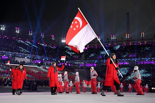 <p>Flag bearer Cheyenne Goh of Singapore and teammates enter the stadium during the Opening Ceremony of the PyeongChang 2018 Winter Olympic Games at PyeongChang Olympic Stadium on February 9, 2018 in Pyeongchang-gun, South Korea. (Photo by Matthias Hangst/Getty Images) </p>