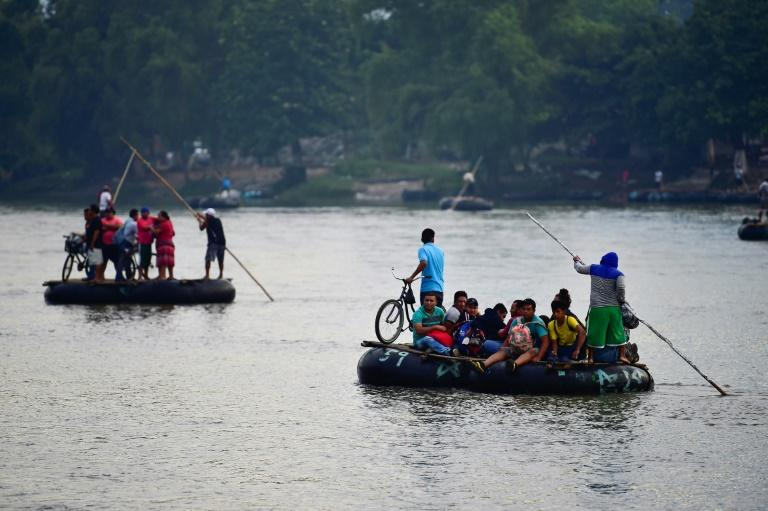 Honduran migrants use makeshift rafts to cross the Suchiate River that marks the border between Guatemala and Mexico