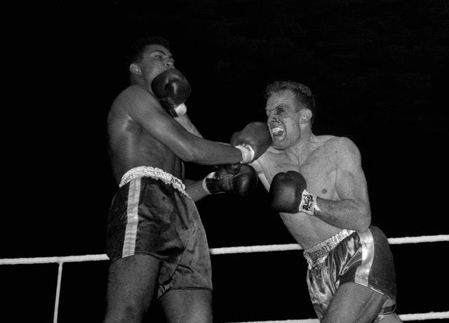 Henry Cooper suffered two painful losses to Muhammad Ali (PA Archive)