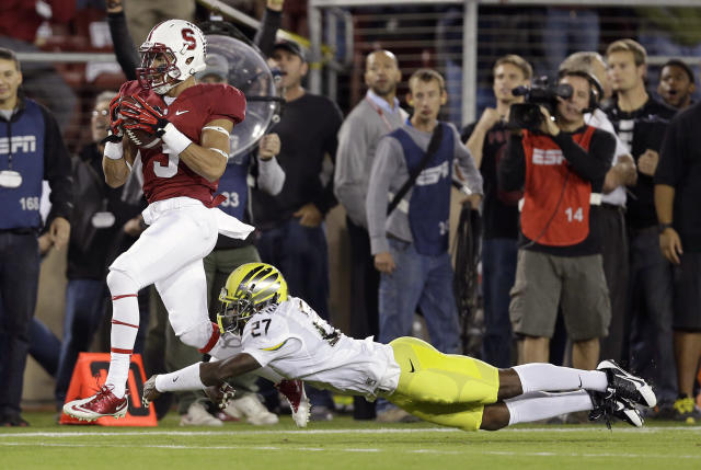 Stanford wide receiver Michael Rector (3) catches a pass as Oregon defensive back Terrance Mitchell (27) dives to tackle him during the first quarter of of an NCAA college football game in Stanford, Calif., Thursday, Nov. 7, 2013. (AP Photo/Marcio Jose Sanchez)