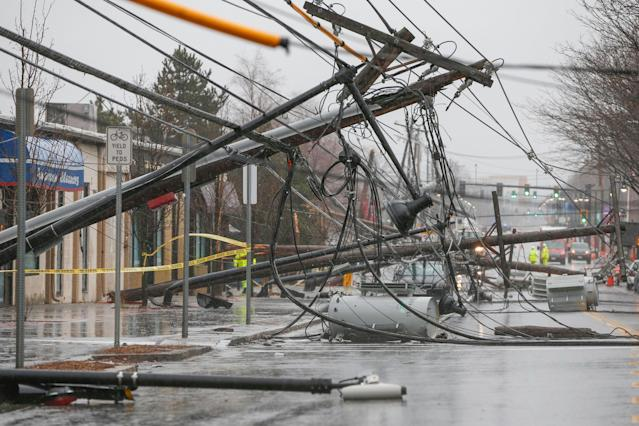 <p>Wind knocks down power poles onto Arsenal Street in Watertown, Mass., March 2, 2018. (Photo: Greg Cooper/EPA-EFE/REX/Shutterstock) </p>
