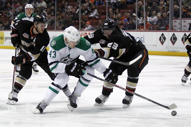 Anaheim Ducks defenseman Francois Beauchemin (23) pushes on Dallas Stars right wing Valeri Nichushkin (43), of Russia for control of the puck with Ducks center Saku Koivu, left, of Finland trailing in the first period of an NHL hockey game Saturday, Feb. 1, 2014, in Anaheim, Calif. (AP Photo/Alex Gallardo)