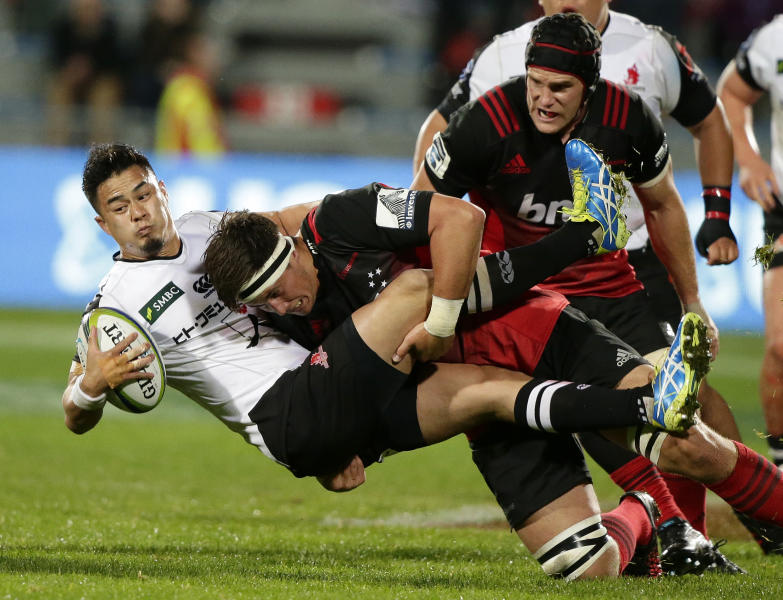 Sunwolves Yu Tamura is tackled by Crusaders Quinten Strange during their Super Rugby match in Christchurch, New Zealand, Friday, April 14, 2017. (AP Photo/Mark Baker)
