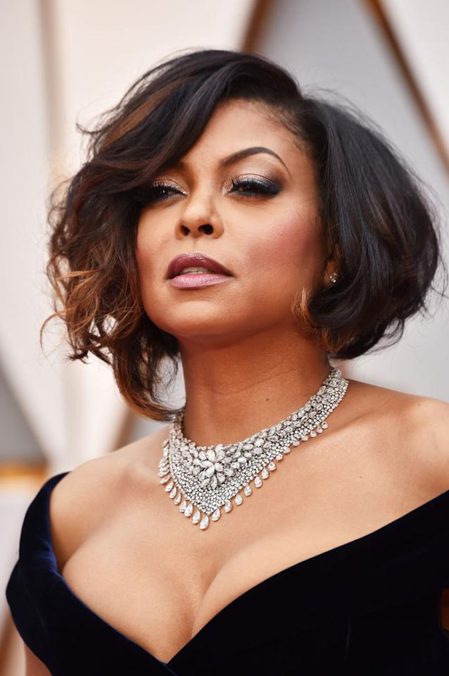 """<p>Celebrity hairstylist Tym Wallace was inspired by Hollywoodicons such as Dorothy Dandridge, Diahann Carroll, and Elizabeth Taylor when he created Henson'schic, touseld bob. He put about three pumps of<a rel=""""nofollow"""" href=""""http://www.dove.com/us/en/hair-care/hair-serum/quench-absolute-supreme-creme-serum.html?gclid=CjwKEAiArIDFBRCe_9DJi6Or0UcSJAAK1nFvpnXzZu0O4oB919lJFqymDL8zvOOLdOHdQ99YNU7XmRoC24Tw_wcB&gclsrc=aw.ds""""><span>Dove Absolute Curls Supreme Crème Serum</span></a>in his hands and distributed the product evenly through her hair before using a jumbo FHI Heat barrel curling iron to create pin curls. He then set her hair using Velcro rollers, which help hold curls in place. (Photo: Getty Images) </p>"""