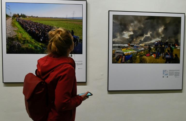 An exhibition showcasing the work of Agence France-Presse photographers who have documented the hope and heartbreak of Europe's migration crisis opened at the Bozar arts centre in Brussels, on May 3, 2017