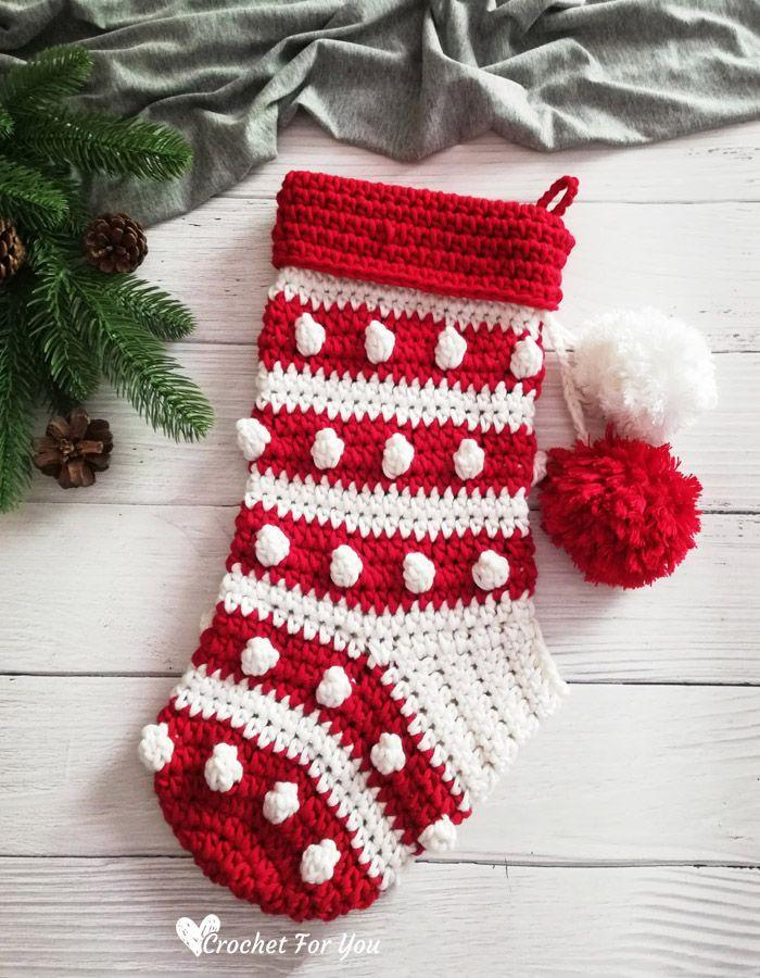 """<p>This adorable Christmas stocking can be crocheted in any two hues, but we love the zippy (and traditional) red and white.</p><p><strong>Get the tutorial at <a href=""""https://www.crochetforyoublog.com/2020/11/crochet-bobbles-stripes-christmas-stocking/"""" rel=""""nofollow noopener"""" target=""""_blank"""" data-ylk=""""slk:Crochet for You"""" class=""""link rapid-noclick-resp"""">Crochet for You</a>.</strong></p><p><strong><a class=""""link rapid-noclick-resp"""" href=""""https://www.amazon.com/s?k=tapestry+needles&i=arts-crafts&ref=nb_sb_noss_1&tag=syn-yahoo-20&ascsubtag=%5Bartid%7C10050.g.28872655%5Bsrc%7Cyahoo-us"""" rel=""""nofollow noopener"""" target=""""_blank"""" data-ylk=""""slk:SHOP TAPESTRY NEEDLES"""">SHOP TAPESTRY NEEDLES</a><br></strong></p>"""