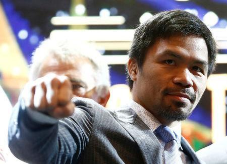 "Philippine boxing icon Manny ""Pacman"" Pacquiao poses for photographers during a news conference with welterweight world title holder Lucas Matthysse (not pictured), for their upcoming WBA ""regular"" welterweight title fight, at a hotel in Kuala Lumpur, Malaysia April 20, 2018. REUTERS/Lai Seng Sin"
