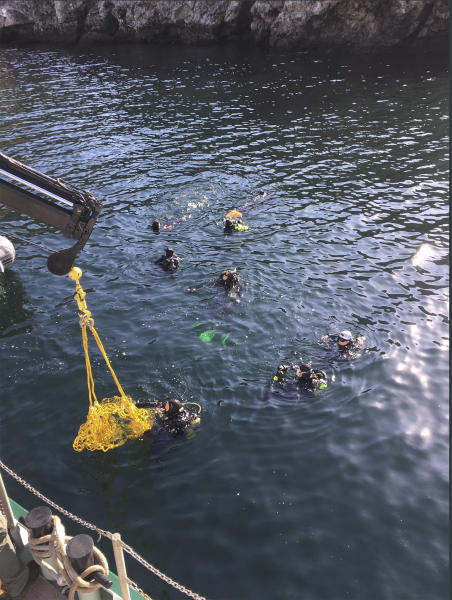 This photo provided by Santa Barbara County on Wednesday, Sept. 4, 2019 shows divers and support crews from many agencies working the scene of the dive boat fire off Santa Cruz Island, Calif. Only one person remained missing on Wednesday. Divers pulled 33 bodies from the seabed and the charred wreckage of the sunken, overturned boat. (Santa Barbara County via AP)