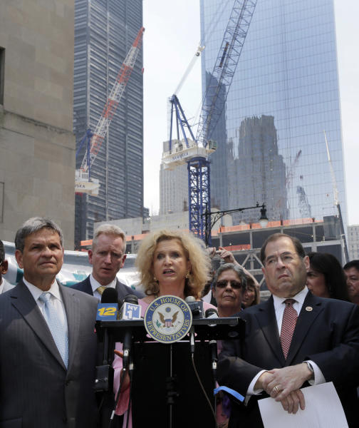 U.S. Rep. Carolyn Maloney, center, flanked by Capt. Al Hagan, left, head of the Uniformed Fire Officers Association, and U.S. Rep. Jerrold Nadler, right, addresses a news conference near the World Trader Center site, in New York, Monday, June 24, 2013. They are are joining community and labor officials and emergency workers to reach out to people who may have been physically affected by the 9/11 attacks to tell them they may still be eligible for health benefits. (AP Photo/Richard Drew)