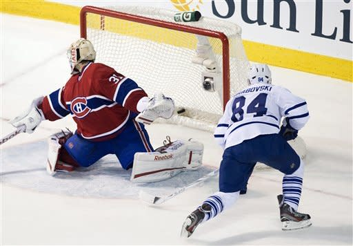 Toronto Maple Leafs' Mikhail Grabovski (84) scores against Montreal Canadiens goaltender Carey Price during third period NHL hockey game action in Montreal, on Saturday, March 3, 2012. (AP Photo/The Canadian Press, Graham Hughes)