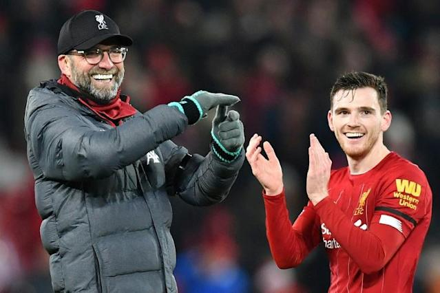 Football 'dad': Andy Robertson (right) says Liverpool manager Jurgen Klopp has been a father figure to the squad (AFP Photo/Paul ELLIS)