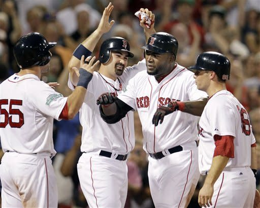 Boston Red Sox's David Ortiz celebrates his grand slam with Ryan Kalish (55), Adrian Gonzalez and Daniel Nava (66), who all scored during the fourth inning of an interleague baseball game against the Miami Marlins at Fenway Park in Boston on Wednesday, June 20, 2012. (AP Photo/Elise Amendola)