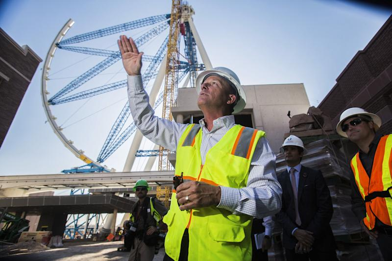 FILE - In a Tuesday, July 30, 2013 file photo, the world's tallest observation wheel, know as the High Roller is seen behind David Codiga, executive project director for The Linq, at The Linq construction site on Las Vegas Boulevard. The outer wheel of the 55-story High Roller ride is scheduled to be hoisted into place Monday, Sept. 9, 2013. (AP Photo/Las Vegas Review-Journal, Jeff Scheid, File) LOCAL TV OUT; LOCAL INTERNET OUT; NVLVS OUT (Las Vegas Sun out)