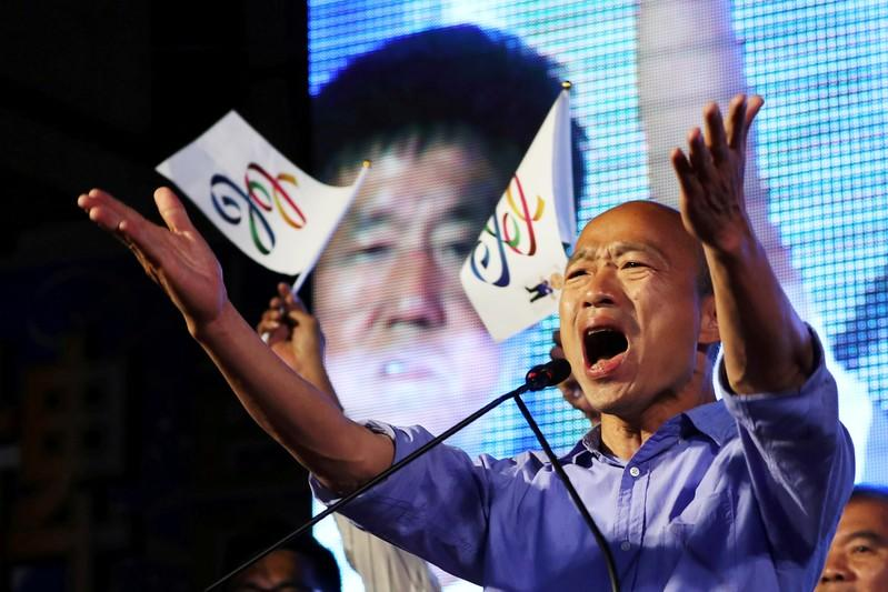 FILE PHOTO: Opposition Nationalist Kuomintang Party (KMT) leader Han Kuo-yu celebrates after winning in local elections in Kaohsiung, Taiwan