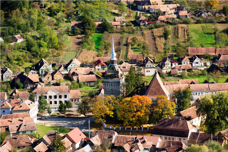 This undated image from Romania Tourism shows rooftops, farms and the church in Saschiz, a town in the Transylvania region of Romania. The area is drawing tourists, including Prince Charles, with quiet scenes of nature and rural life, including rhubarb and elderberry farms. (AP Photo/Romania Tourism)