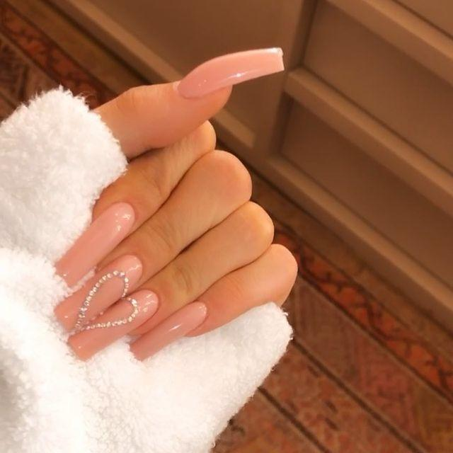"""<p>The queen of over-the-top nail designs does it again! Kylie went full on 1999, showing off nude coffin nails with a rhinestone heart.</p><p><a href=""""https://www.instagram.com/p/B2k545hHKnP/"""" rel=""""nofollow noopener"""" target=""""_blank"""" data-ylk=""""slk:See the original post on Instagram"""" class=""""link rapid-noclick-resp"""">See the original post on Instagram</a></p>"""