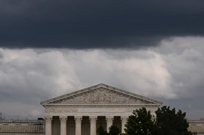 FILE PHOTO: Clouds form over the U.S. Supreme Court in Washington