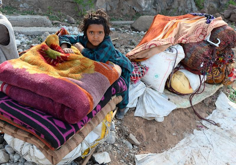 Many of the Bakarwals speeded up their annual migration out of the Hindu-majority Jammu region because of the national storm of controversy created by the killing of the eight-year-old girl (AFP Photo/SAJJAD HUSSAIN)