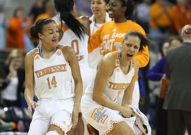 Tennessee guard Andraya Carter (14) and forward Cierra Burdick (11) celebrate a play in Tennessee's win over LSU in an NCAA college basketball game in the quarterfinals of the Southeastern Conference women's tournament, Friday, March 7, 2014, in Duluth, Ga. Tennessee defeated LSU 77-65. (AP Photo/Jason Getz)