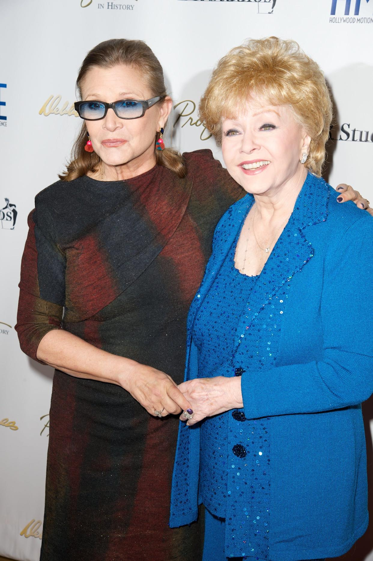 """Carrie Fisher and Debbie Reynolds attend the all-star gala and press preview of """"Profiles in History's Debbie Reynolds"""" on May 14, 2014, in North Hollywood, California."""