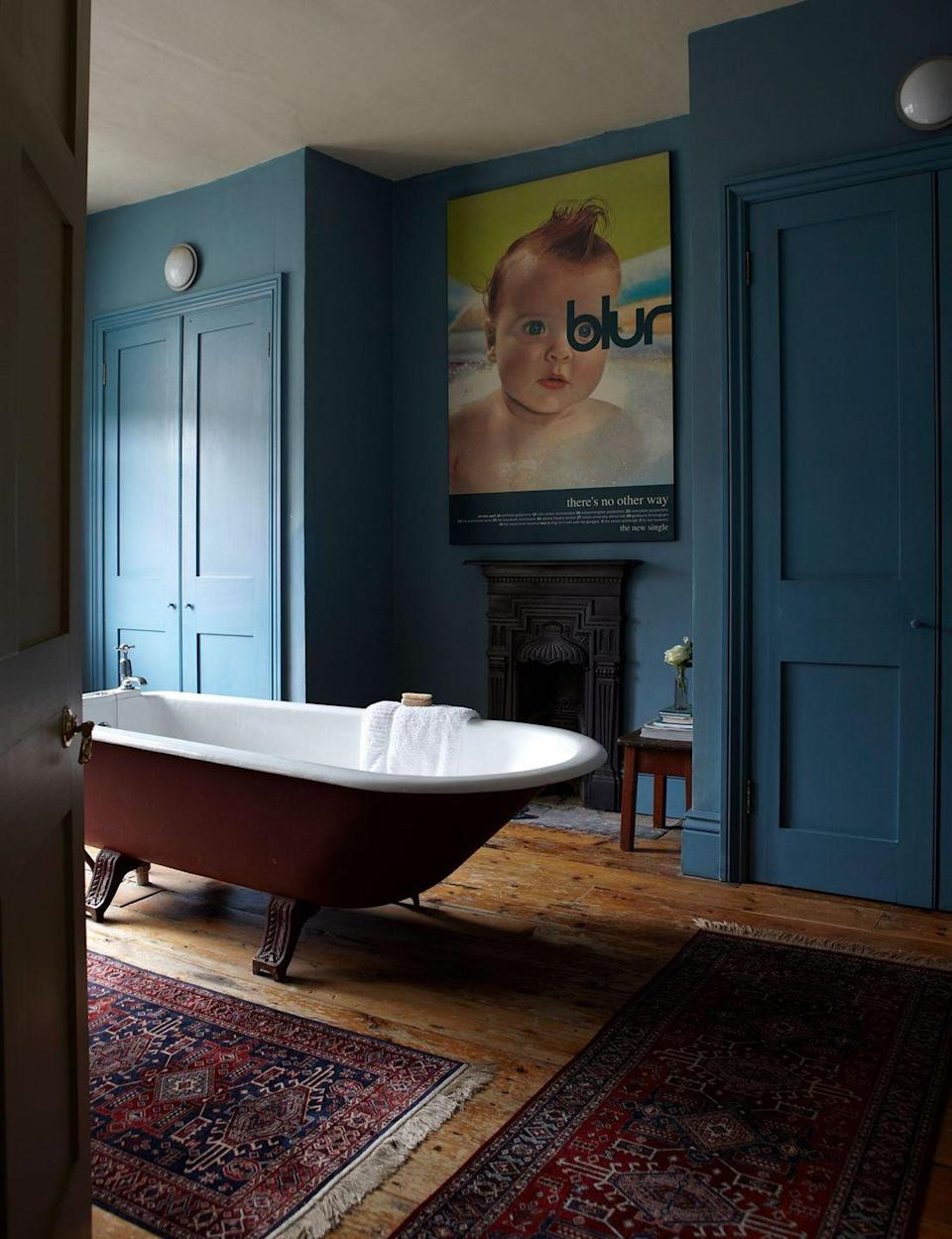 """<p>A jewel-toned blue and deep burgundy colour combination brings a richness and sense of luxury to a room. The splash of chartreuse in the form of a modern graphic poster, and the natural wooden flooring, prevent this scheme from becoming too heavy. <br></p><p>Pictured: <a href=""""https://go.redirectingat.com?id=127X1599956&url=https%3A%2F%2Fwww.farrow-ball.com%2Fpaint-colours%2Fstone-blue&sref=https%3A%2F%2Fwww.redonline.co.uk%2Finteriors%2Feasy-to-steal-ideas%2Fg37326104%2Fcolour-combinations%2F"""" rel=""""nofollow noopener"""" target=""""_blank"""" data-ylk=""""slk:Stone Blue by Farrow & Ball"""" class=""""link rapid-noclick-resp"""">Stone Blue by Farrow & Ball</a></p>"""