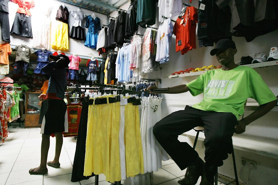 A Zimbabwean man sits in his store, a clothing shop in Zimbabwe's capital, Harare on December 24, 2008 (AFP Photo/Desmond Kwande)