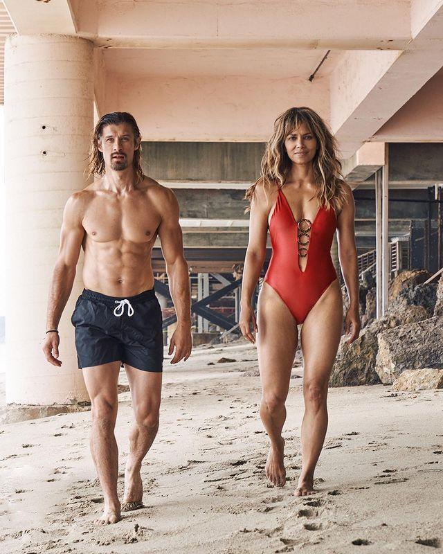 """<p>The actor brought the Baywatch vibes to the beach in this photo.</p><p>In the photo the 54-year-old walks towards the camera wearing a red swimsuit with black lace tie-ups at the front. </p><p><a href=""""https://www.instagram.com/p/CEKhNVVpiQ7/?utm_source=ig_web_copy_link"""" rel=""""nofollow noopener"""" target=""""_blank"""" data-ylk=""""slk:See the original post on Instagram"""" class=""""link rapid-noclick-resp"""">See the original post on Instagram</a></p>"""