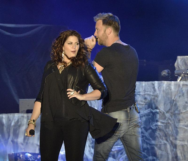 "FILE - In this Saturday, April 27, 2013 file photo, singer Hillary Scott, left, and singer Charles Kelley of the band Lady Antebellum perform on Day 2 of the 2013 Stagecoach Music Festival at the Empire Polo Club, in Indio, Calif. NBC says it's lining up musical artists including Rod Stewart to perform on ""The Voice"" in May. The network said Monday, April 29, 2013, that Stewart, CeeLo Green, Lady Antebellum, Robin Thicke, Pharrell Williams and T.I. will take the stage on upcoming episodes of the hit singing contest. (Photo by Dan Steinberg/Invision/AP, File)"