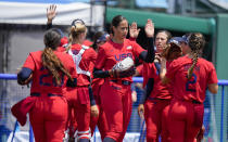 United States' Cat Osterman celebrates with teammates during the softball game between Italy and the United States at the 2020 Summer Olympics, Wednesday, July 21, 2021, in Fukushima , Japan. (AP Photo/Jae C. Hong)