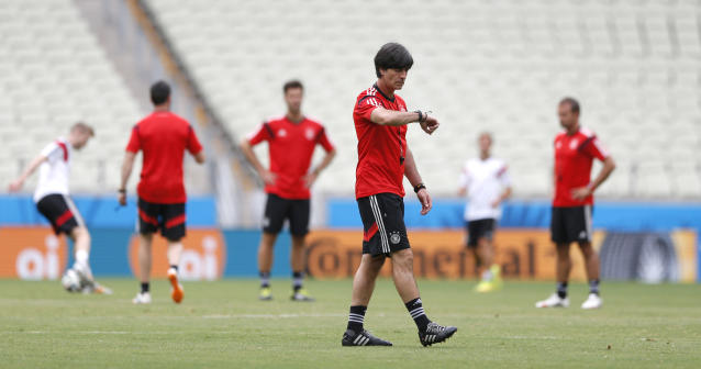 German national soccer team head coach Joachim Loew checks the time during an official training session the day before the group G World Cup soccer match between Germany and Ghana at the Arena Castelao in Fortaleza, Brazil, Friday, June 20, 2014. (AP Photo/Matthias Schrader)