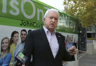 FILE - In this Nov. 1, 2018, file photo, Republican gubernatorial candidate John Cox talks to reporters before beginning a statewide bus tour in Sacramento, Calif. A fading coronavirus crisis and an astounding windfall of tax dollars have reshuffled California's emerging recall election, allowing Democratic Gov. Gavin Newsom to talk of a mask-free future and propose billions in new spending for schools and businesses as he looks to fend off Republicans who depict him as a foppish failure. (AP Photo/Rich Pedroncelli, File)