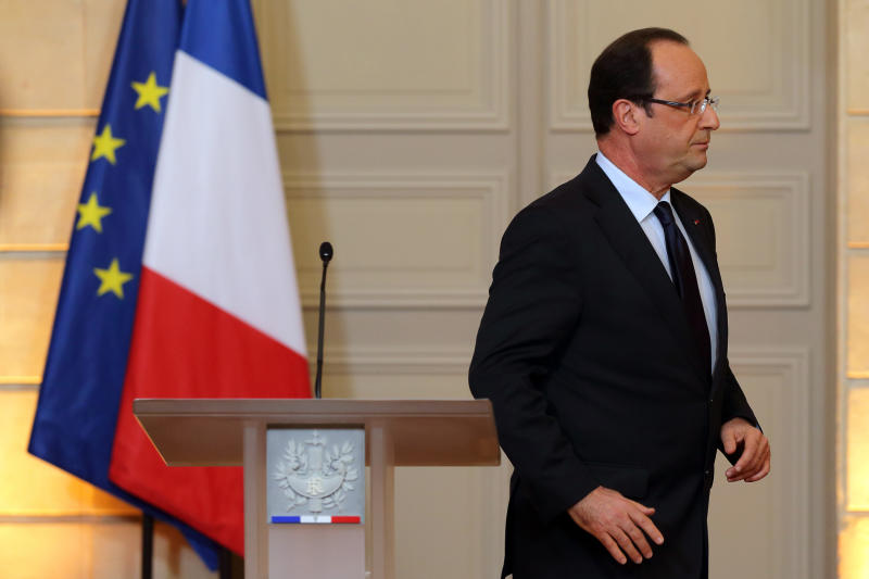 """France's President Francois Hollande  leaves after delivering a speech on the situation in Mali at the Elysee Palace in Paris, Friday, Jan. 11, 2013. French forces began backing Malian soldiers Friday in their fight against radical Islamists, drawing the former colonial power into a military operation to oust the al-Qaida-linked militants nine months after they seized control of northern Mali.  French President Francois Hollande said  that the operation would last """"as long as necessary"""" and said it was aimed notably at protecting the 6,000 French citizens in Mali. Kidnappers currently hold seven French hostages in the country.  (AP Photo/Philippe Wojazer, Pool)"""