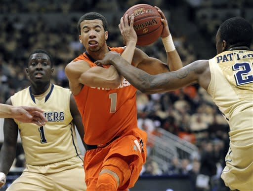 Syracuse Michael Cartier-Williams, center, drives against Pittsburgh during the first half of an NCAA college basketball game in Pittsburgh, Saturday, Feb. 2, 2013. (AP Photo/John Heller)