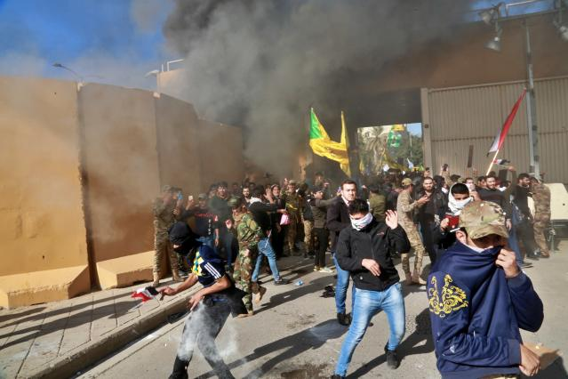U.S. soldiers fire tear gas at protesters who broke into the U.S. Embassy compound in Baghdad on Dec. 31. (Photo: Khalid Mohammed/AP)