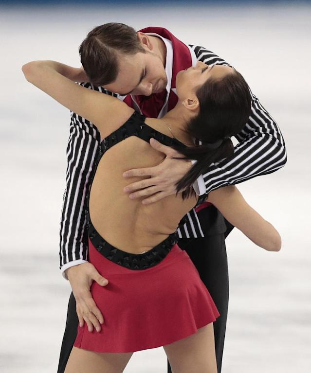 Ksenia Stolbova and Fedor Klimov of Russia compete in the pairs free skate figure skating competition at the Iceberg Skating Palace during the 2014 Winter Olympics, Wednesday, Feb. 12, 2014, in Sochi, Russia. (AP Photo/Ivan Sekretarev)