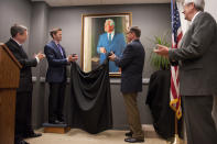 UNITED STATES - SEPTEMBER 22: From left, Sen. Mark Kirk, R-Ill., Reps. Aaron Schock, R-Ill., Bobby Schilling, R-Ill., and Senate Historian Donald Ritchie unveil a portrait of former Senate Minority Leader Everett Dirsken, R-Ill., which will reside in Kirk's Hart Building office. The portrait is a copy of Richard Harryman's 1968 original. (Photo By Tom Williams/Roll Call)