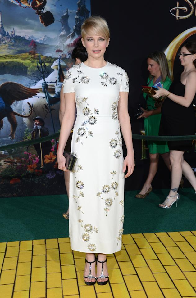 """HOLLYWOOD, CA - FEBRUARY 13:  Actress Michelle Williams arrives for the world premiere of Walt Disney Pictures' """"Oz The Great And Powerful"""" at the El Capitan Theatre on February 13, 2013 in Hollywood, California.  (Photo by Jason Kempin/Getty Images)"""