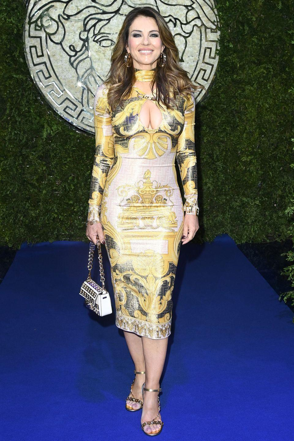 <p><strong>26 September</strong></p><p>Elizabeth Hurley wore a dress showcasing the iconic Versace print.</p>