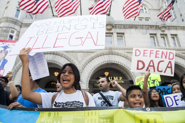 "<p>Immigration rights demonstrators hold signs in front of the Trump International Hotel in Washington to oppose President Trump's decision to end the DACA program for ""dreamers"" on Tuesday, Sept. 5, 2017. (Photo : Bill Clark/CQ Roll Call/Getty Imaages) </p>"