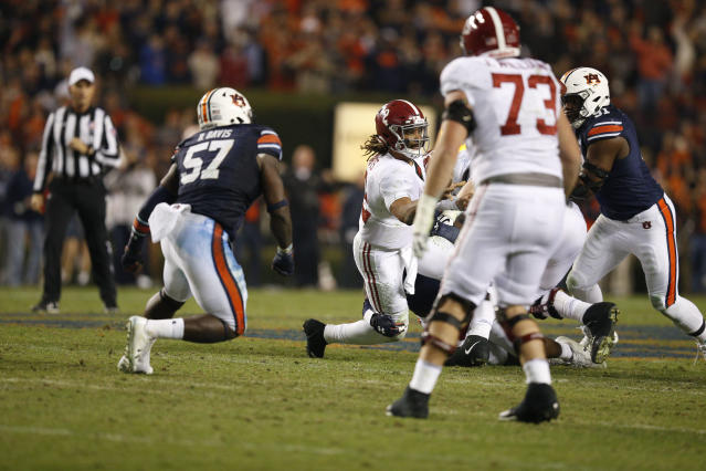 Alabama quarterback Jalen Hurts passes the ball during the second half of the Iron Bowl against Auburn, Saturday, Nov. 25, 2017, in Auburn, Ala. (AP Photo/Brynn Anderson)